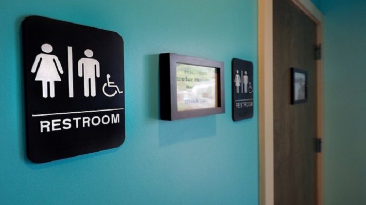 DURHAM, NC - MAY 10:  Unisex signs hang outside bathrooms at Toast Paninoteca on May 10, 2016 in Durham, North Carolina.  Debate over transgender bathroom access spreads nationwide as the U.S. Department of Justice countersues North Carolina Governor Pat McCrory from enforcing the provisions of House Bill 2 (HB2) that dictate what bathrooms transgender individuals can use.  (Photo by Sara D. Davis/Getty Images)