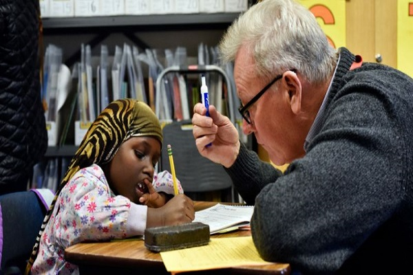At this Dallas school, it takes a village to help refugee kids learn to read