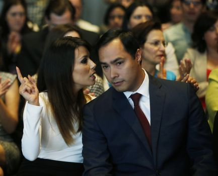 Actress Eva Longoria speaks with Rep. Joaquin Castro, D-Texas, at an event launching The Latino Victory Project, a Latino political action committee, at the National Press Club in Washington, Monday, May 5, 2014.