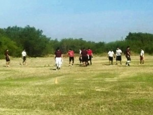 EXCLUSIVE: Border Children in Laredo Play Football as Cartel Smugglers Run Drugs Across Field