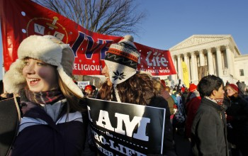 Abby Ross of Redding, Pa., left, and Jennifer Rodriguez of Chicago, Ill., join anti-abortion activists gathered in front of the U.S. Supreme Court, in Washington, Monday, Jan. 24, 2011, during a rally against Roe v. Wade on the anniversary of the U.S. Supreme Court decision.  (AP Photo/Manuel Balce Ceneta)